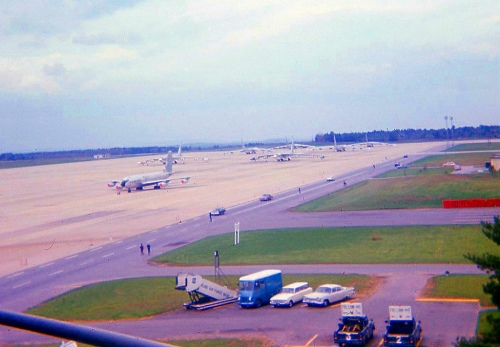 Pease Air Force Base at Portsmouth, New Hampshire. The picture was taken in the May 1966 from the balcony of the operations building. I was in the 7th grade. There is one KC-135 and six B-52s on the runway.